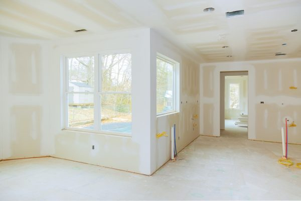 Interior construction of housing project with drywall installed and patched without painting applied