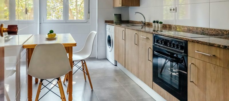 Kitchen interior with furniture and appliances