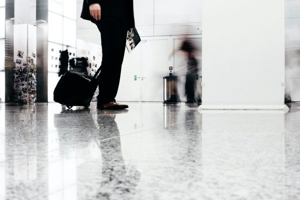 Low section of businessman with luggage at office