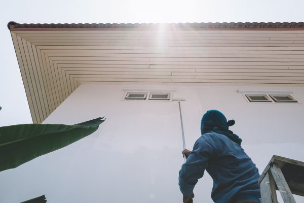 Man painting white wall