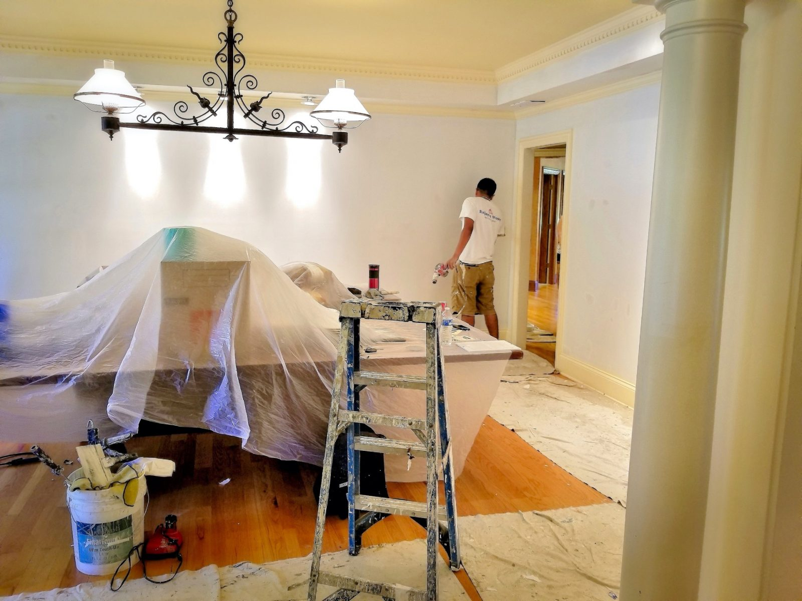 Painters paint a room during a remodel