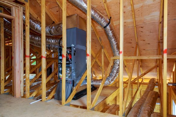installation of heating system on the roof of the pipe system of heating close up