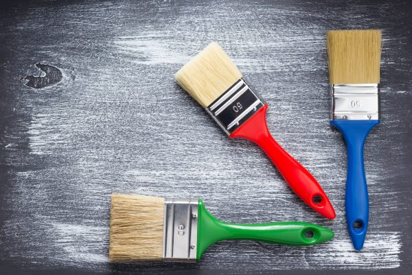 paint brush on wooden painted background